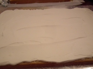 Evenly spread cream to edges of cake