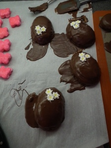 Eggs dipped in Chocolate with royal icing flower