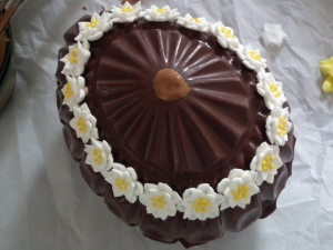 Adding royal icing flowers - pretty!